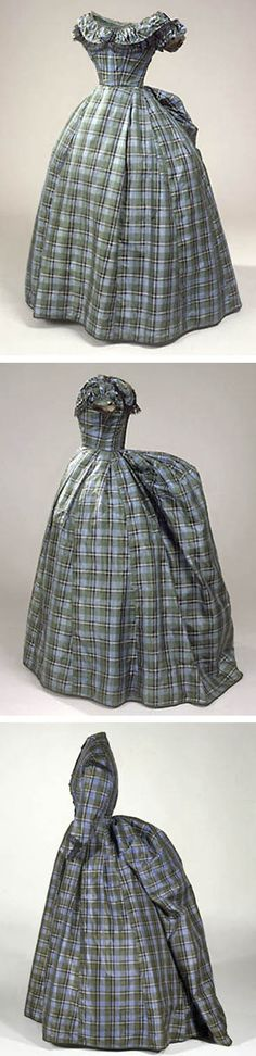 Green, blue, black, and white plaid taffeta, ca. late 1860s. The crinoline was going out of fashion and the bustle was considered modern. Two bodices (one short-sleeved, the other long-sleeved), both trimmed with black lace, and skirt, which has drawstrings for bustle. Bodices lined in white canvas, skirt in white gauze-like substance. Danish National Museum