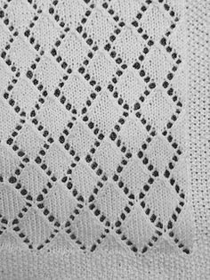 I wanted to create an heirloom for my first grandchild. This lovely, lightweight baby blanket is worked in light fingering or heavier lace weight yarn using small needles. The work is fine and takes time, but worthwhile for a blanket that can be passed down through the family.