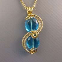 MTS blue glass crystal creation | One-of-a-kind | Quality non-tarnish gold wires from US | Dimension 2cm x 5cm.  Complimentary gold oxidized nickel-free non-tarnish chain at 55cm long with handmade clasp. (beaded chain in picture for sample only) Removable and interchangeable with MTS pendants/...
