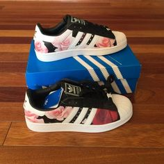 Adidas superstar sneakers Size US 6.5 BRAND NEW! Never worn! Limited floral edition! I am a size 7 and bought these hoping these would fit me and they didn't  I am selling them for what I paid but I am open for reasonable offers! No trades please  Adidas Shoes Sneakers