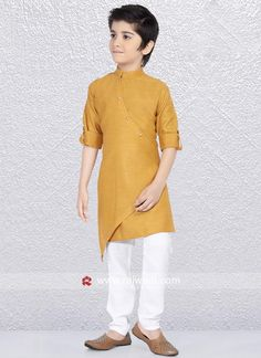 Charming Golden yellow color kurta made from Linen cotton fabric. Fancy side buttons are complete the look. Paired with contrast White color trouser. #rajwadi #kidswear #boys #ethnic #traditional #modern #trendy #fashionable #kidsfashion