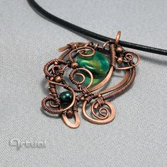 Hammered copper wire pendant with dichroic glass bead by Artual