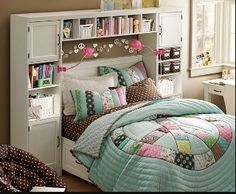 Like the idea of putting some additional shelving around her bed/headboard to give her more storage for books, cds, etc.