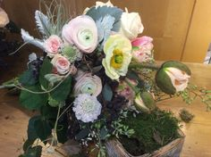 Soft pink ranunculus, paper like poppies, scabiosa and dusty miller create a one of a kind bouquet. in bloom. Kingston ON