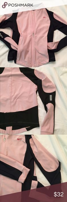 Nike Running Jacket Nike Jacket in light mauve/rose with brown semi sheer mesh panels. Size small (4-6). Cut is fitted with jacket curving lower in front and straight in back. Back key / card zipper pocket. Reflective dots on right elbow. Full zipper. Fit Dry. I can't find any stains or flaws. It is used in excellent condition. Nike Jackets & Coats