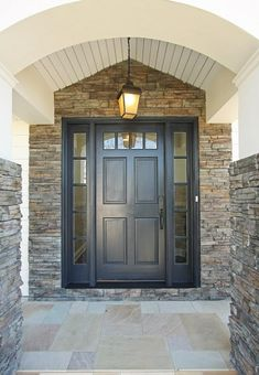 This door is perfect with the stone an tile.