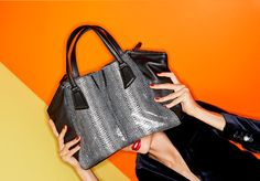 Luxe embossed snakeskin elevates our exclusive Botkier satchel, a chic and well-sized trapezoidal design with an optional shoulder strap for wearability.