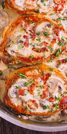 Smothered Pork Chops with creamy mushrooms, bacon and thyme sauce.