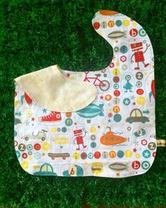 Oversized No Mess Reversible Bib in Zoom / Yellow Stripes. Wear it on your tot during feeding time. The oversized bib protects your child's clothing... No need to worry about spills, stains and mess! Best especially for moms who are scared of getting their child's clothes dirty! =)  Send us a message at info@ilovebabinski.com & LIKE us on Facebook  Php 120.00 www.ilovebabinski.com