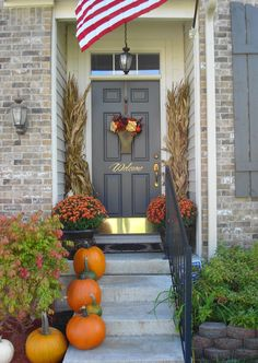 Symmetry helps maximize the impact of this narrow front stoop. A good reminder to consider space and proportions when decorating the front porch of a #newhome.