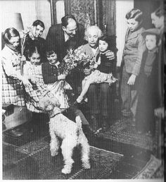 Albert Einstein with his wire fox terrier, Chico, on his 70th birthday.