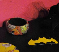 Harley Quinn Bangle Bracelet  (made with comics) & handpainted Batman Barrette.      Available at Missconstrued Boutique   (also available online by request)  http://facebook.com/robotrowboat  info@robot-rowboat.com