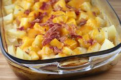 """Ranch potatoes: 8-10 medium potatoes (cut into ½"""" cubes) 1 can cream of mushroom soup (undiluted) 1 ½ cups milk 1 envelope ranch dressing mix 2 cups shredded cheddar cheese (divided) salt and pepper 6 bacon slices (cooked until crispy and crumbled)"""