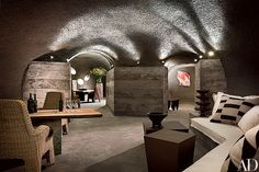 The cave walls have a sprayed-concrete finish | archdigest.com