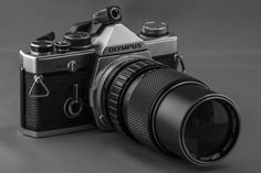 A Camera Lens And Careful Days - Olympus OM-2n MD with Zuiko 75-150mm f/4.0 lens