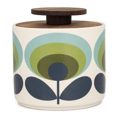 Bring Orla Kiely's signature style to your interior with this Flower storage jar. Crafted from 100 earthenware, this distinctive storage jar comes complete with a South American walnut lid.