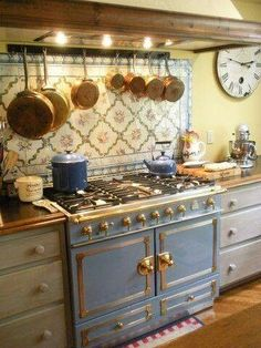 What a great stove! This is a great post on using copper when decorating - French Inspired Kitchens.