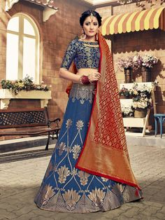 Celebrate your special occasions in this rich blue Banarasi silk lehenga choli ensemble! The blue silk lehenga choli is detailed with shimmery ethnic and floral patterns. A maroon Banarasi silk blouse having shimmery ornate details completes the gorgeous Lehenga Choli Online, Lehenga Saree, Bridal Lehenga, Anarkali, Choli Designs, Lehenga Designs, Blouse Designs, Dress Designs, Navy Blue Lehenga