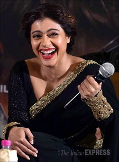 Kajol, who was stunning in a black Sabyasachi sari, in splits at the press conference
