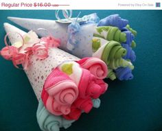 Washcloth bouquets. Could also do this with onesies. Cute baby shower gift.