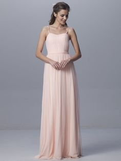 Simple bridesmaid dress was made of chiffon covered with a soft tulle overlay. Spaghetti straps on the strapless bodice with flowing skirt finished the look. Colored in blush, backless, matching with sash.