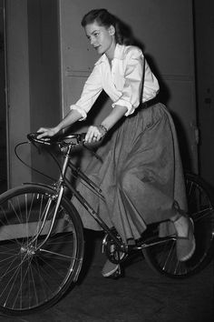 Screen actress Lauren Bacall wastes no time as she leaves movie set on bicycle after day's shooting, circa 1948