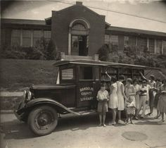Children reading books next to the Randolph County Library bookmobile in Randolph County, Alabama. :: Alabama Photographs and Pictures Collection