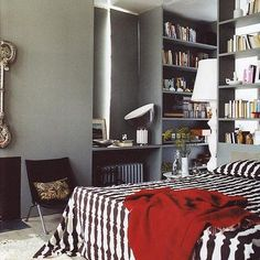 Isle Crawford bedroom, grey walls with shot of red throw