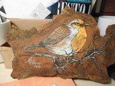 A pretty songbird painted on a piece of old trusty tin.