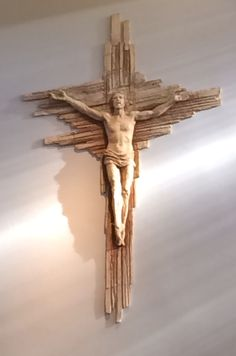 See shadow of Christ! I don't know if that was intentional by the sculptor, but it only shows up while the sun is setting through the window. It is most clear during the consecration! It is in St Paul's Catholic Church in Phoenix, AZ!