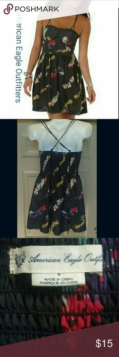 American Eagle Floral Summer Dress Navy blue floral print American Eagle Outfitter dress with pockets! cross back straps. Front bodice has rubber lining in bust to prevent slipping. Pair with strappy sandals or throw on a cardigan for early spring! American Eagle Outfitters Dresses Mini