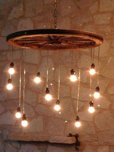 Znalezione obrazy dla zapytania wooden wheel chandelier