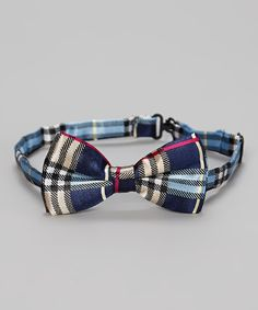 This dapper bow tie helps young men dress to impress. An adjustable band ensures a comfortable fit.