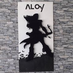 This is the silhoutte of Aloy; the protagonist of Horizon Zero Dawn.