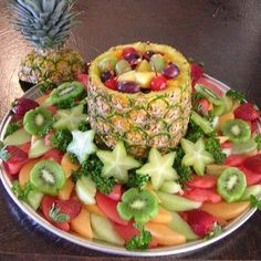 Cool fruit basket idea but with dip in the pineapple.