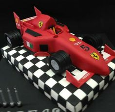 This boy loves speed! Ferrari chocolate cake on checkered chocolate base. The post This boy loves speed! Ferrari chocolate cake on checkered chocolate base. appeared first on ferrari. Bolo Ferrari, Ferrari Cake, Ferrari Party, Ferrari F1, Racing Cake, Race Car Cakes, Car Cakes For Boys, Cake Design For Men, Dad Cake
