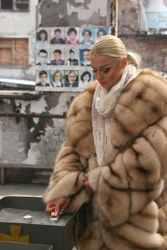 Fur coat of sable.  Pastel brown, more rose beige in color than golden.