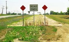 "The end of Route 66, sort of. An abandoned section in Illinois. ""The Fine Art Photography of Frank Romeo."""