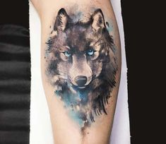 e933d399c Awesome 2 colors abstract tattoo style of Wolf with Blue Eyes motive done  by tattoo artist