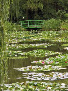 Japanese bridge and lily pond in the garden of the Impressionist painter Claude Monet, Giverny, Eure, Normandy, France, Europe