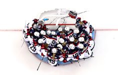 The U.S. team huddles around the net prior to the women's ice hockey preliminary round group a game against the Canada on day five of the Sochi 2014 Winter Olympics at Shayba Arena, Feb. 12, 2014 in Sochi, Russia.