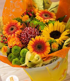 Seville Bag Bouquet | Orange Flowers Gift Bag | Bunches.co.uk~ My favourite website for my orders to family & friends to the UK... been using them for over 5yrs & they have never let me down or disappointed! Great service, great flowers, great prices!!