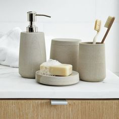 Stoneware bath accessories - for the guest bathroom, with the copper faucet!  EEKS!