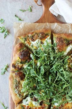 Pesto Pizza with Herbed Ricotta - Cook Nourish Bliss Recipe for arugula pesto pizza. With herbed ricotta, walnuts and lemon zest! Fresh, herby and cheesy!Recipe for arugula pesto pizza. With herbed ricotta, walnuts and lemon zest! Fresh, herby and cheesy! Pesto Pizza, Arugula Pizza, Fig Pizza, Ricotta Pizza, Lemon Pizza, Prosciutto Pizza, Veggie Pizza, Grilled Pizza, Vegetarian Recipes