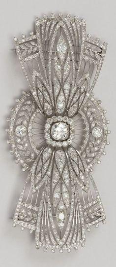 Boucheron - An Art Deco platinum and diamond bow brooch, circa 1920. #Boucheron #ArtDeco