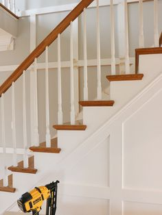 I got a nail gun for Christmas and put it to work right away by adding molding to my entryway and stairway. Wall Trim Molding, Staircase Molding, Picture Rail Molding, Stairs Trim, Moldings And Trim, Entryway Stairs, Entry Hallway, Foyer Design, Staircase Design