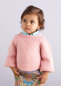 This fashion-forward Round Yoke Baby Sweater is a simple knit with a lot of flair! Your favorite tots will look too cute when back to school season rolls around again. Sized 0-6 months, 6-12 months,12-18 months, 2 years and 3 years.