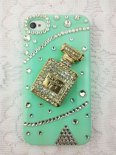Turquoise Rhinestone iphone 4s case!! I love the bling perfume bottle in the middle!!