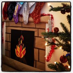 Grab some construction paper, shipping paper,  tissue paper and create your own fireplace