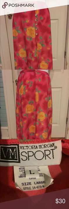 Hot Pink Floral Vintage Skirt size Large Hot Pink Floral Vintage Skirt size Large by Victoria Morgan Sport  Perfect Condition, also has a slit at the bottom.   Waist: 32 in  Length: 34 in Hips: 52 in Vintage Skirts Maxi